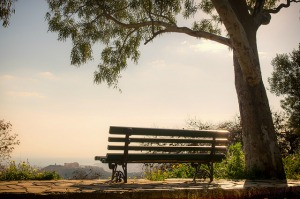 "<img src=""image.gif"" alt=""A bench in a park"" />"