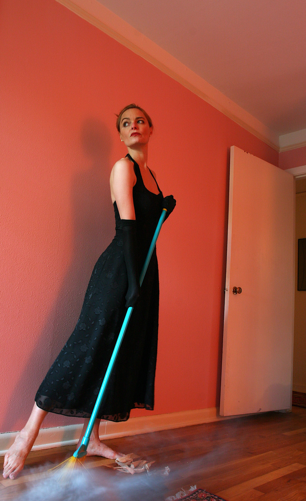 lady cleaning in evening gown