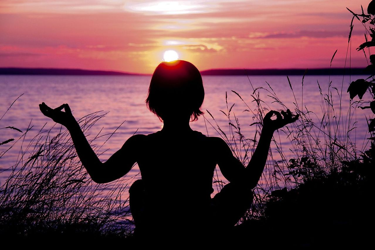 little-boy-doing-yoga-poses-at-sunset-2-1331159-1279x852