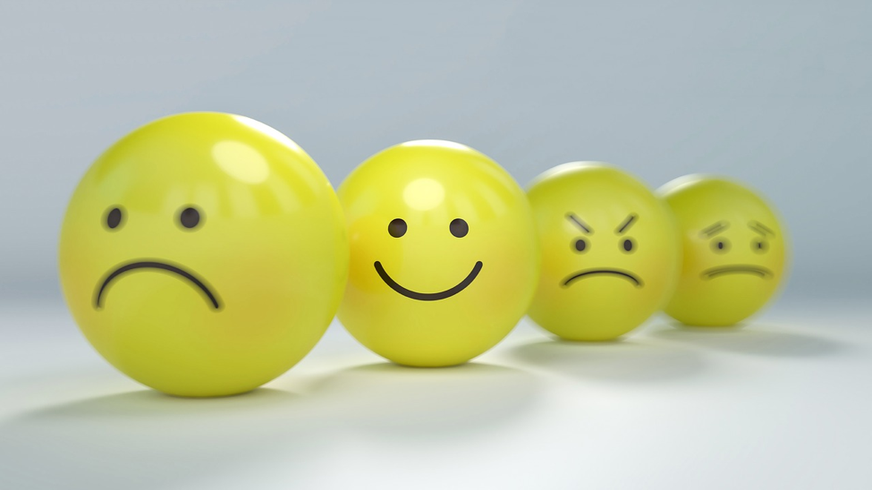 happy face balls with different emotions