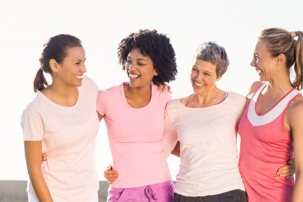 laughing women wearing pink for breast cance